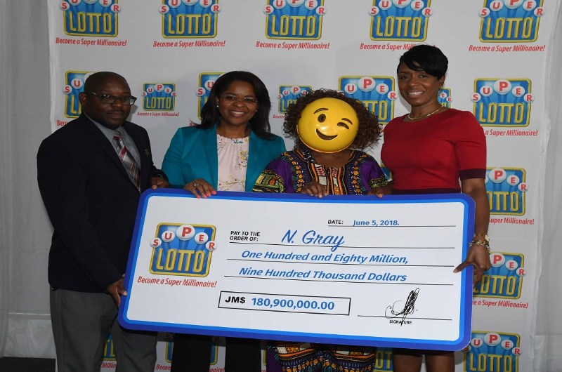 Lottery winner wears winking face emoji mask whilst collecting
