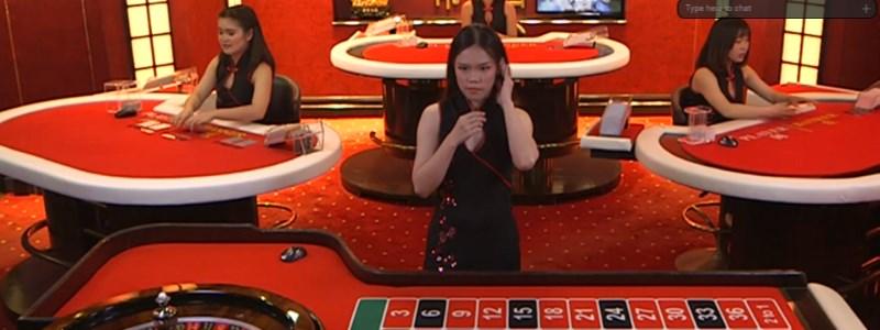 Asian Dealer at live roulette table