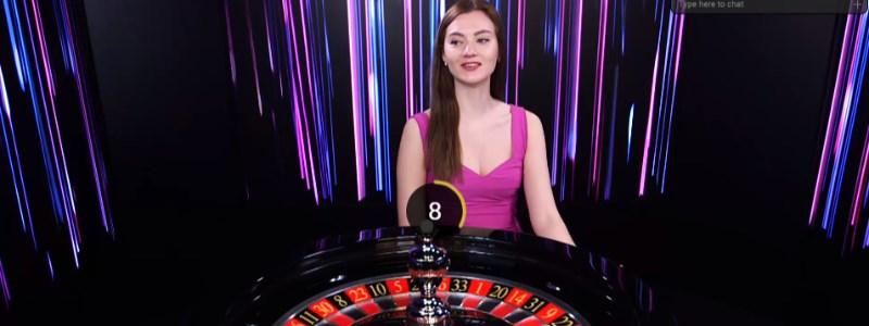 European live dealer at the roulette wheel