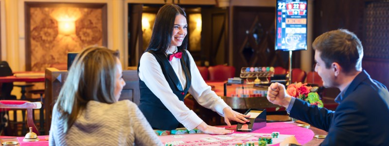 Blackjack dealer at the table