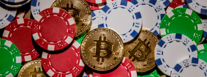 Bitcoin and casino chips in pile