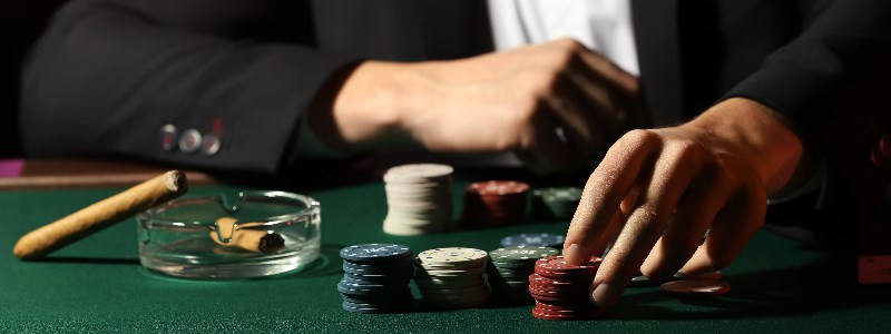 High roller casino player toying with chips