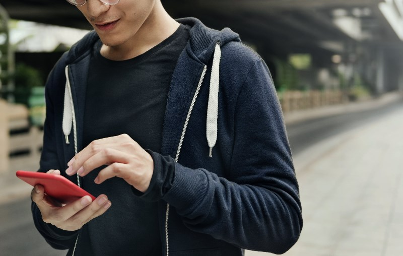 Swiss man playing games on phone